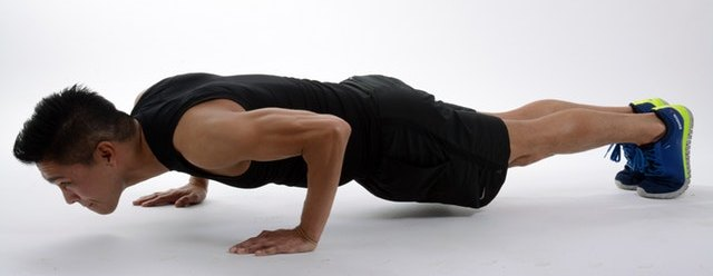 Man Performing Press Up Core Exercise Routine for Effective Kettlebell Workouts