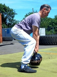 Kettlebell Instructor about to perform a Double Arm Row Kettlebell Workout